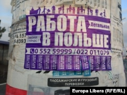 """A sign in Chisinau advertises a hotline for """"legal"""" work in Poland, a European Union member. With a Gross Domestic Product per capita of just over $4,510, Moldova ranks as one of the poorest countries in Europe."""