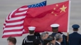 U.S. -- The flags of China and the United States are flown before the arrival of President of China Xi Jinping (not pictured) at Joint Base Andrews, Maryland, outside Washington DC, USA, 30 March 2016.