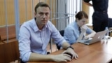 "RUSSIA -- Russian opposition leader Aleksei Navalny (L), who was detained at a recent protest called under the slogan ""Putin is not our tsar"", attends a court hearing in Moscow, May 15, 2018"
