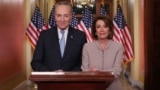 U.S. -- U.S. Speaker of the House Nancy Pelosi and Senate Minority Leader Chuck Schumer pose for photographers after concluding their joint response, to President Trump's prime time address, on Capitol Hill in Washington, U.S., January 8, 2019