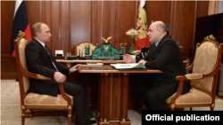 Russian President Vladimir Putin meets with Mikhail Mishustin on January 15, 2019.