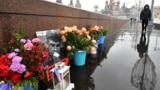 RUSSIA -- People lay flowers at the site where late opposition leader Boris Nemtsov was fatally shot on a bridge near the Kremlin, in central Moscow, February 27, 2020