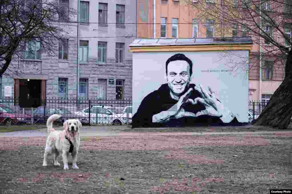 The mural depicted Navalny making the heart gesture to his wife from a glass defendants' cage in a Moscow courtroom in early February after he was sentenced and taken away to a Russian prison for 2 1/2 years.