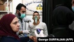 Молодой человек в госпитале после предполагаемой химической атаки в Алеппо 24 ноября 2018 года