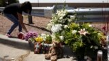 US - A woman places flowers at the site of a mass shooting where 20 people lost their lives at a Walmart in El Paso, Texas, U.S. August 4, 2019.