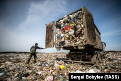 A truck dumps garbage at the Yadrovo solid-waste landfill in the village of Yadrovo. On March 21, 2018, dozens of children were hospitalized with suspected poisoning from gases leaking from the landfill.