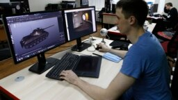 A programmer for Game Stream, a branch of video game company Wargaming, at work in Minsk in 2016.