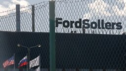 Vsevolozhsk, Leningrad Region, Russia - a factory of Ford Sollers / A view through a fence shows a factory of Ford Sollers, a joint venture of U.S. carmaker Ford with Russian partners, March 27, 2019