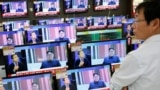 South Korea - A sales assistant watches TV sets broadcasting a news report on North Korea's fifth nuclear test, in Seoul, South Korea, September 9, 2016