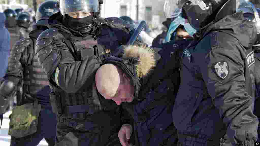 A man is detained in the Russian Far East city of Khabarovsk. The city was the site of large-scale demonstrations in 2020 against the July 2020 arrest of a popular regional governor, Sergei Furgal, for alleged involvement in murders - a charge the governor denied. Demonstrators saw Furgal's arrest  as intended to eliminate a potential rival to President Vladimir Putin.
