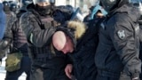 RUSSIA -- Police detain a man during a protest against the jailing of opposition leader Alexei Navalny in Khabarovsk, 6,100 kilometers (3,800 miles) east of Moscow, Russia, Saturday, Jan. 23, 2021. Authorities in Russia have taken measures to curb protest