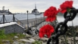 MURMANSK REGION, RUSSIA - JULY 2, 2019: Flowers left by mourners in the port of Severomorsk in memory of 14 Russian Navy officers who died in a fire on a submersible in Russian waters on 1 July 2019.