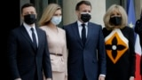 FRANCE -- French President Emmanuel Macron, second right, and his wife Brigitte Macron, right, pose with Ukrainian President Volodymyr Zelenskiy, left, and Olena Zelenska before a working lunch at the Elysee palace in Paris, April 16, 2021