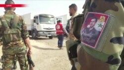 """В осажденную Асадом Восточную Гуту прибыл первый гуманитарный конвой от """"Красного полумесяца"""""""