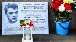 RUSSIA – Memorial with fresh flowers and a portrait in memory of Russian politician Boris Nemtsov at the scene of his murder. Moscow, Juny 9, 2020