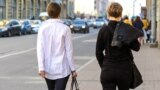 Saint-Petersburg, Russia. Two women on the street from the back