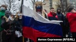 Участник акции протеста 23 января в Москве