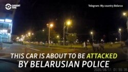 'Stop, Guys!, Stop!': Dramatic Video Shows Driver Attacked By Belarusian Police