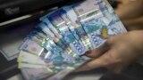 Азия: пикет у Банка Астаны и паралимпийская сборная по плаванию в Кыргызстане