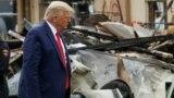 U.S. President Donald Trump views property damage to a business during a visit to Kenosha