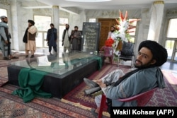Taliban fighters congregate near the tomb of the late Afghan mujahideen leader Ahmad Shah Masud, the brother of Ahmad Wali Masud, in Panjshir Province on September 15, 2021.
