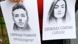 LATVIA - A woman holds a portrait of opposition journalist Roman Protasevich and his girlfriend Sofia Sapega during a protest of solidarity with Roman Protasevic at the Belarusian embassy in Riga, Latvia, 25 May 2021