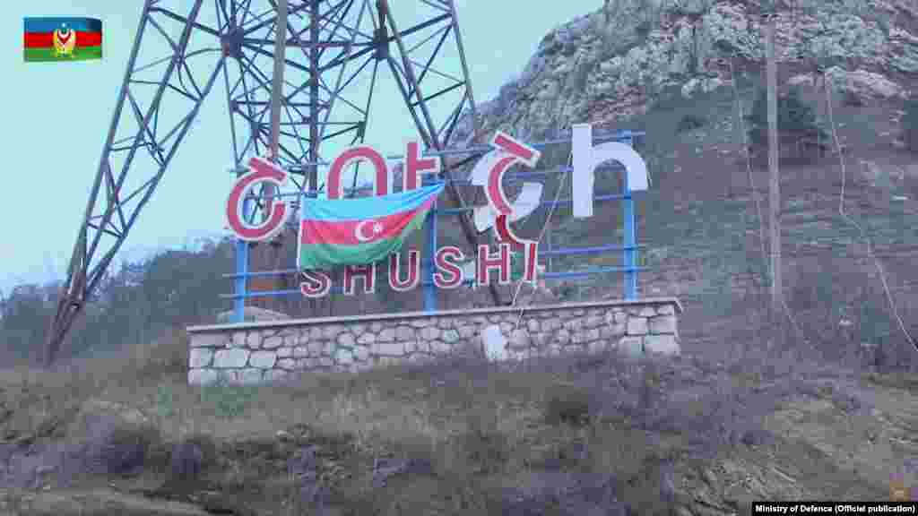A November 9, 2020 YouTube video from the Azerbaijani Defense Ministry shows an Azerbaijani flag on the Armenian-English signboard for the town of Shushi (Shusha).