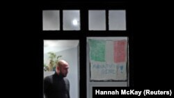 """A sign in Italian that reads """"Everything will be OK,"""" a phrase that has appeared on banners across Italy as a message of hope amidst the COVID-19 pandemic, hangs in the window of a residential building in Streatham, a suburb of London."""