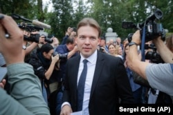 Lawyer Maksim Znak, a member of the opposition's Coordination Council, is surrounded by reporters upon arriving at the Investigative Committee headquarters, where he was summoned for questioning in Minsk on August 21. He was arrested on September 9.