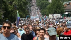 Tens of thousands of protesters march in Khabarovsk on July 18.