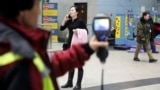 Kazakhstan - Kazakh sanitary-epidemiological service worker uses a thermal scanner to detect travellers from China who may have symptoms possibly connected with the previously unknown coronavirus, at Almaty International Airport, Kazakhstan January 21, 20