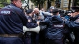 RUSSIA -- Police officers block protesters at a rally against alleged violations ahead of elections to Moscow City Duma, the capital's regional parliament, in Moscow, July 14, 2019