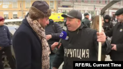 "With ""Corruption"" emblazoned on his chest and a scythe in his hand, one Nemtsov march participant in Moscow called on Russians to mow down the vice. ""Corruption is Russia's coronavirus,"" he quipped to Current Time's Timur Olevsky."