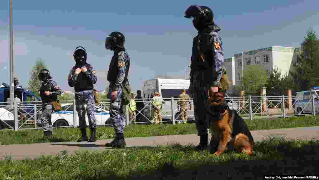 For additional security, law enforcement stand in the vicinity of School No. 175 on May 11, 2021. Russian President Vladimir Putin has called for tighter regulations on the private ownership of guns similar to that used in the attack. The type has not been specified, but gun owners in the region are being scrutinized, AP reported.