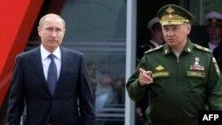 Путин и министр обороны России Сергей Шойгу
