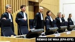 The judges take their seats in the courtroom of the heavily secured Schiphol Judicial Complex at the start of the international MH17 trial in Badhoevedorp, The Netherlands on March 9, 2020.