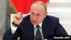 RUSSIA -- Russian President Vladimir Putin gestures speaks at the Kremlin in Moscow, September 23, 2020