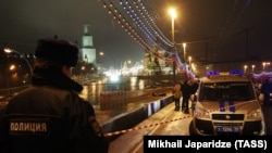 A police officer seen at the site of Russian opposition leader Boris Nemtsov's February 27, 2015 murder on Moscow's Bolshoi Moskvoretsky Bridge.