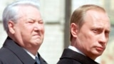 Russia - Former Russian president Boris Yeltsin (L) stands close to Russian President Vladimir Putin in Moscow in this May 7, 2000 file photo