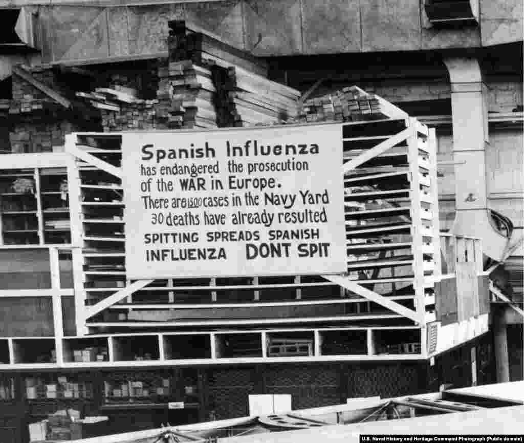 На плакате написано, что не надо плевать на землю. Надпись вывесили в октябре 1918 года на входе на тот самый завод морской авиации. Из всех городов США Филадельфия пострадала от испанки больше всего