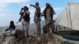 AFGHANISTAN -- Afghan militia fighters keep a watch at an outpost against Taliban insurgents at Charkint district in Balkh Province, JUly 15, 2021