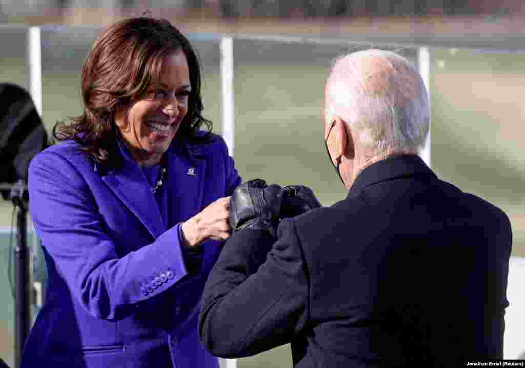 Kamala Harris bumps fists with Joe Biden after being sworn in as the first female vice-president of the United States. Harris is also the first person of Jamaican or Indian descent to be elected to the post.