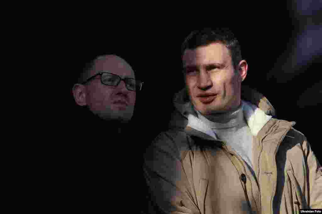 Ukrainian opposition leaders Arseniy Yatsenyuk and Vitali Klitschko speak to protesters in Independence Square on December 29, 2013.