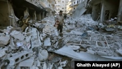 Разрушенный город в Идлибе