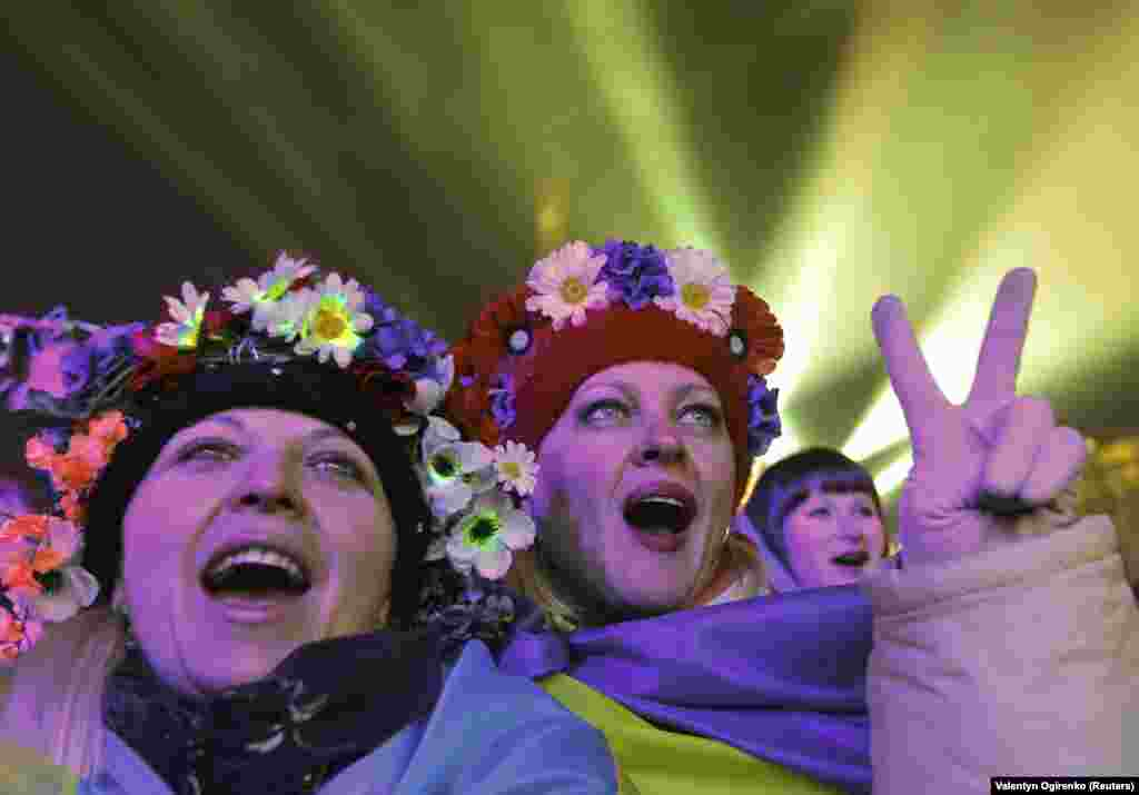 Pro-European protesters take part in New Year celebrations on Independence Square in central Kyiv on January 1, 2014.