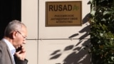 RUSSIA -- A man walks past a sign outside the office of Russian Anti-Doping Agency (RUSADA) in Moscow, September 20, 2018