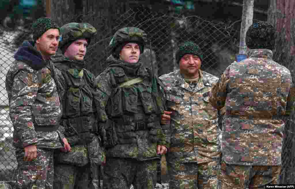 Over the past few weeks, posing for photos with Russian peacekeepers has become a standard pastime for Azerbaijani and Armenian servicemen alike. Here, Armenian soldiers are featured with two Russian peacekeepers (center) two days before the return of Azerbaijani troops to the town of Kalbacar (Karvachar in Armenian) on November 25, 2020. The Kalbacar region was the second territory restored to Azerbaijani control under Armenia, Azerbaijan, and Russia's November 9, 2020 ceasefire agreement.