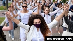 Women dressed in white clothes in Minsk, Belarus on August 12, 2020 protest against police violence during recent rallies against suspected election fraud.