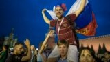 RUSSIA -- Russia soccer fans celebrate their team victory against Spain in Red Square after the round of 16 match between Spain and Russia at the 2018 soccer World Cup at the Luzhniki Stadium in Moscow, July 1, 2018