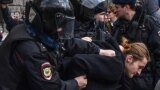 Russian riot police detain a participant in protests in front of the FSB headquarters in Moscow on March 14.